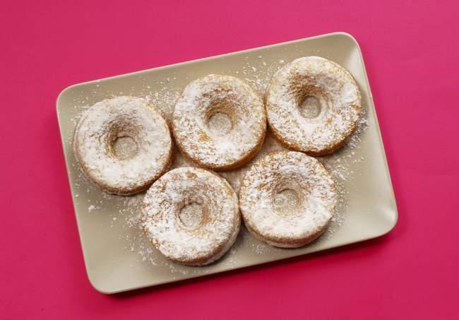 Five doughnuts with sugar — Stock Photo