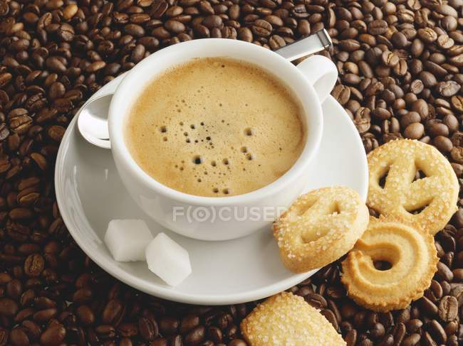 Cup of coffee with sugar — Stock Photo