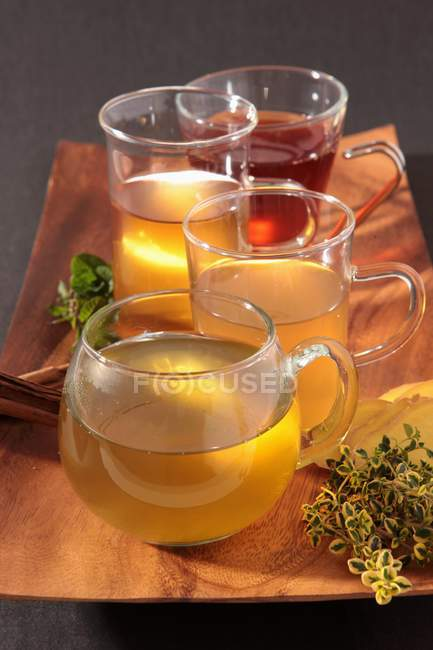 Elevated view of various herb teas in tea cups — Stock Photo