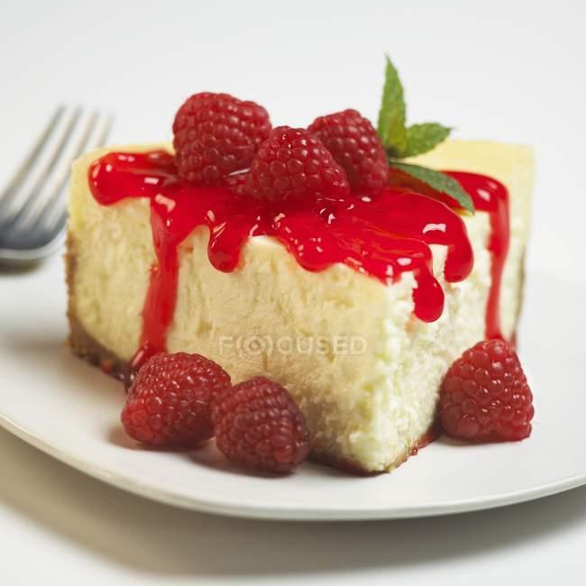 Slice of Cheesecake with Sauce — Stock Photo