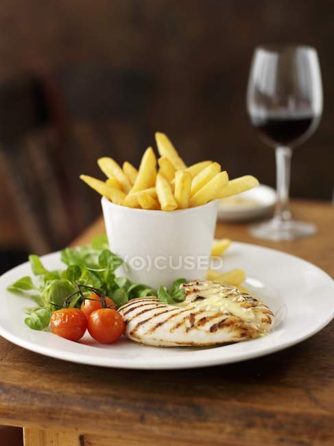 Chicken breast with potato fries — Stock Photo