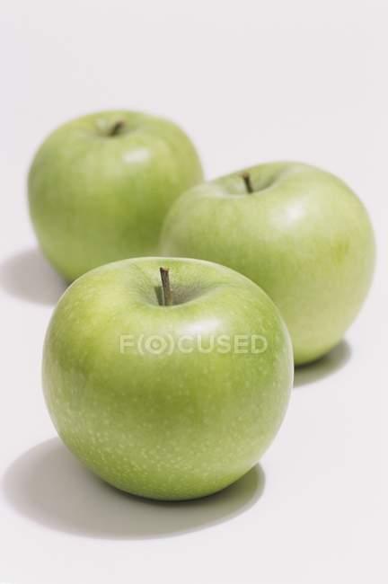 Three Granny Smith apples — Stock Photo