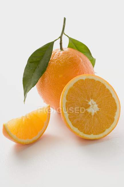 Orange with stalk and leaves — Stock Photo