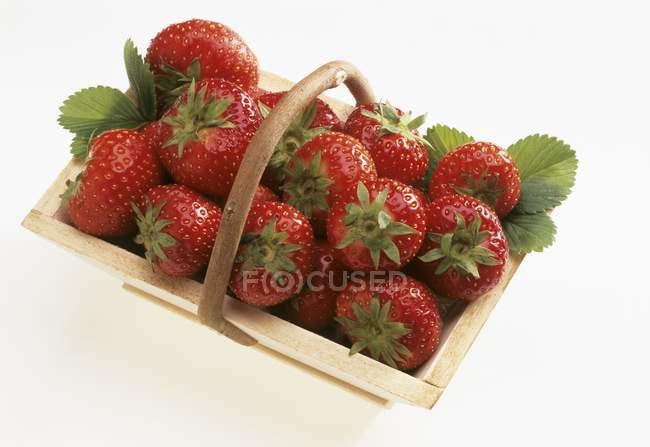 Strawberries in wooden basket — Stock Photo