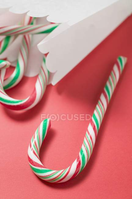 Candy canes in paper bag — Stock Photo
