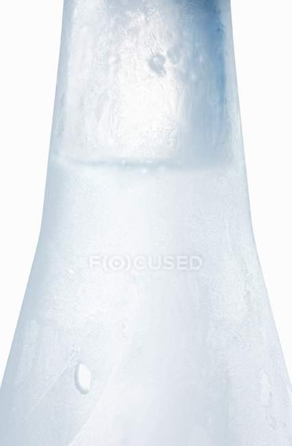 Closeup view of Ouzo in icy bottle — Stock Photo