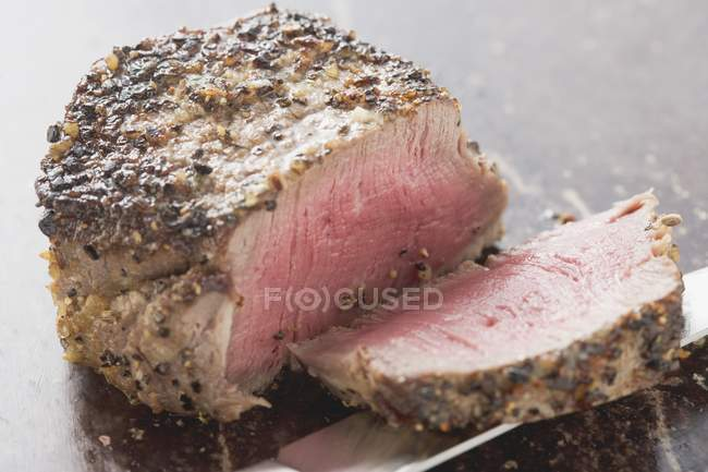 Slice of peppered steak — Stock Photo