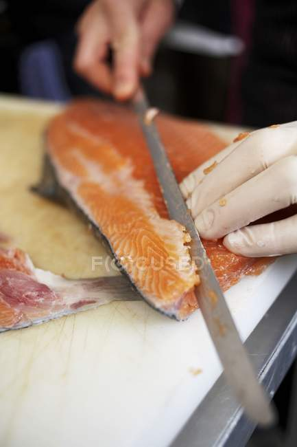 Chef preparing salmon — Stock Photo