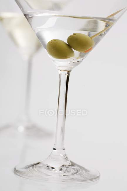 Martini with olives — Stock Photo