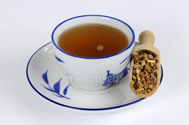 Cup of Woad root tea — Stock Photo