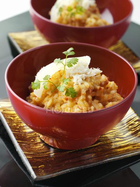Crab risotto rice with greenery — Stock Photo
