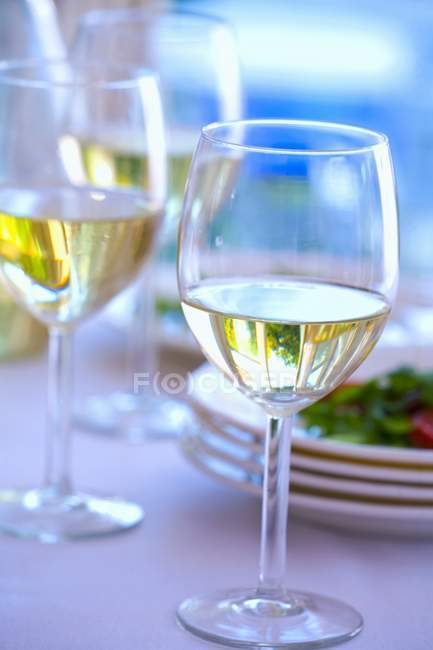 Several glasses of white wine — Stock Photo