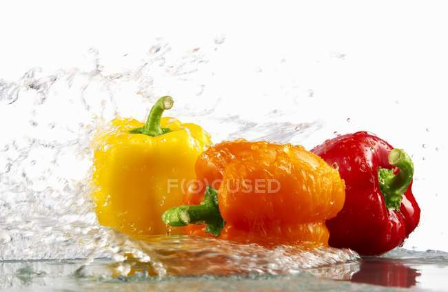 Yellow and orange peppers — Stock Photo