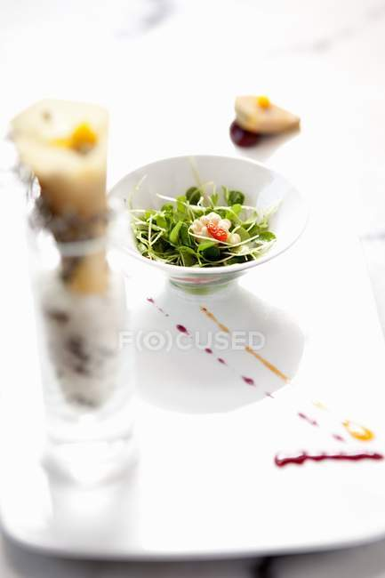 Elevated view of fresh vegetable seedlings and nut salad — Stock Photo