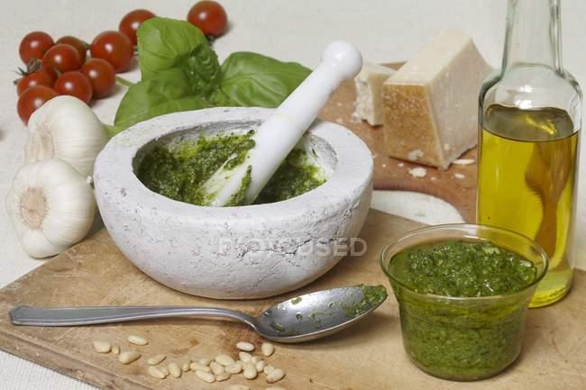 Pesto in white mortar — Stock Photo