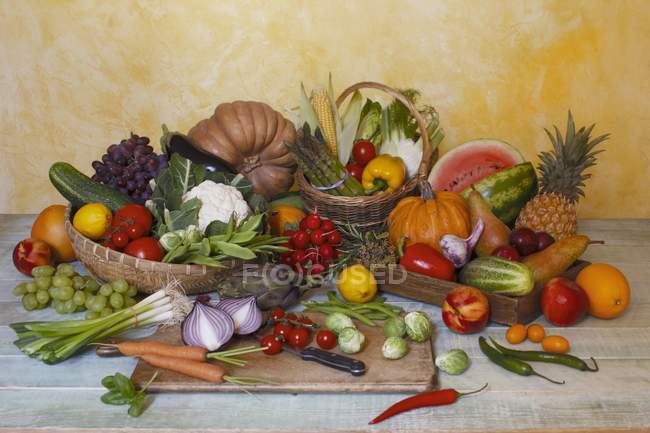 Fruit and vegetable still life over wooden surface — Stock Photo