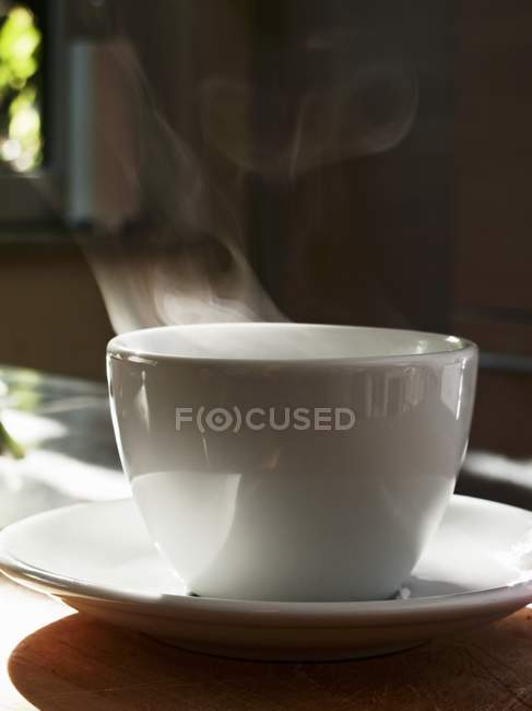 Steaming cup with tea — Stock Photo