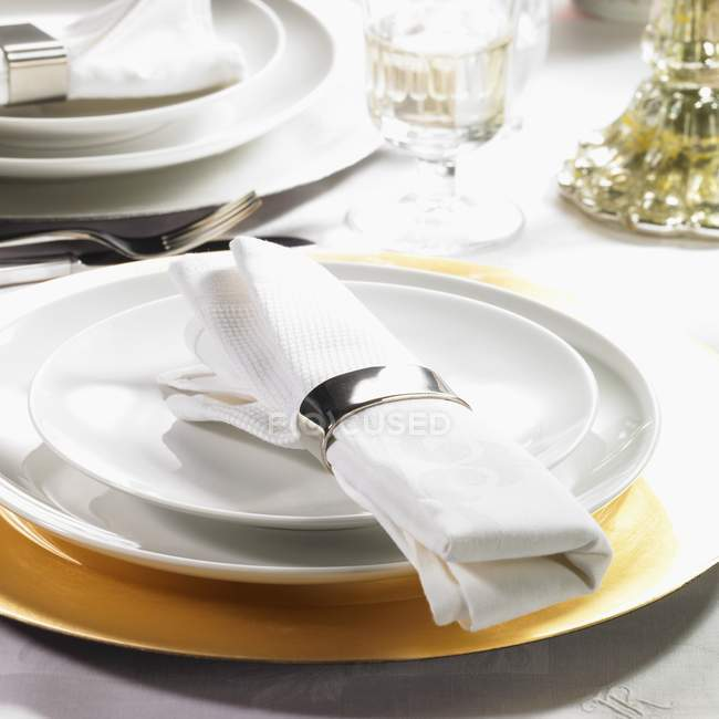 Festive place setting with fabric napkin — Stock Photo