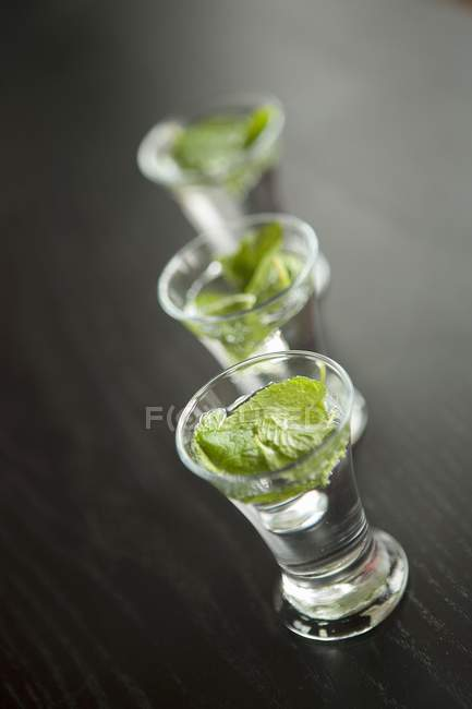 Closeup view of mint tea in three glasses — Stock Photo