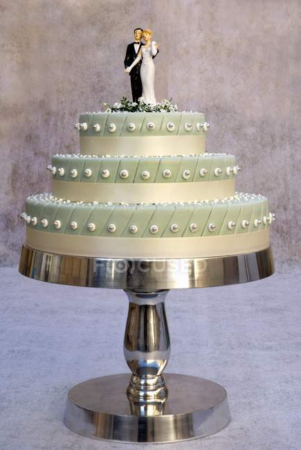 Three-tiered wedding cake — food, gastronomy - Stock Photo   #151069158