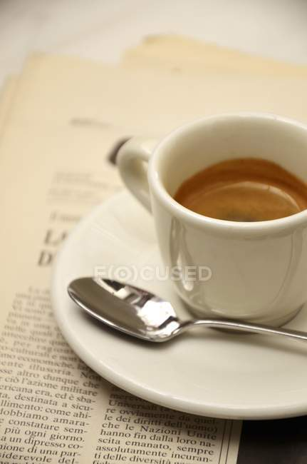 Cup of hot espresso with spoon — Stock Photo