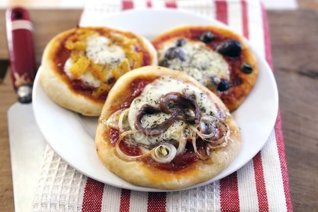 Three mini pizzas — Stock Photo