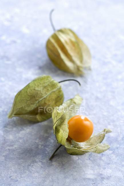 Physalis fruits with and without capes — Stock Photo