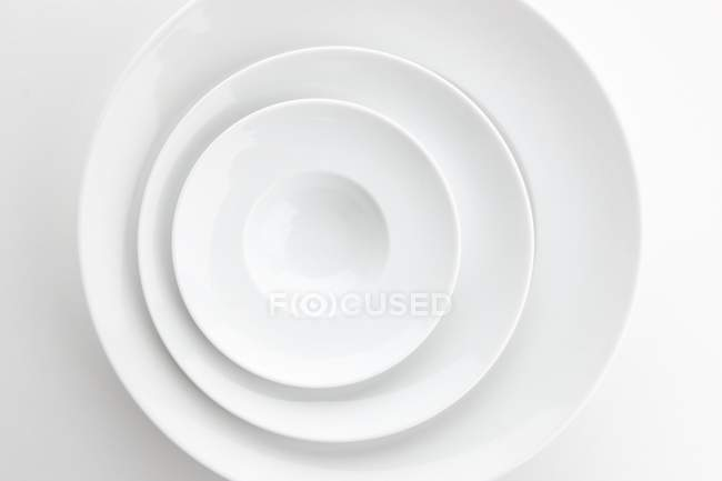 Stack of plates seen from above — Stock Photo