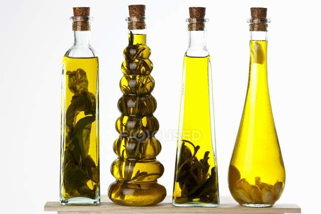 Bottles of olive oil with various aromas — Stock Photo