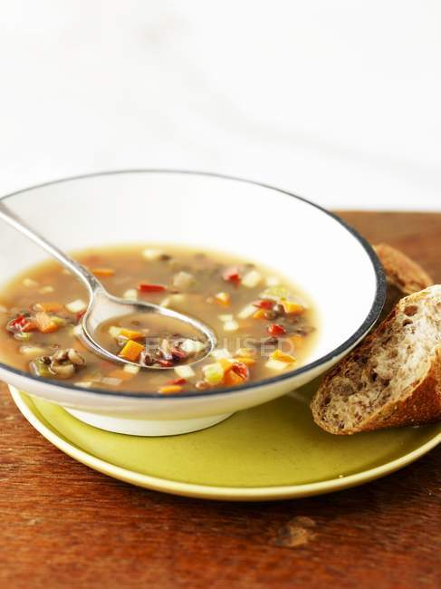 Vegetable soup with bread — Stock Photo