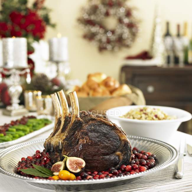Close up of  Crown Roast Pork on a Platter of Cranberries — Stock Photo