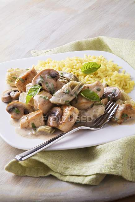 Basil chicken in creamy sauce with rice — Stock Photo