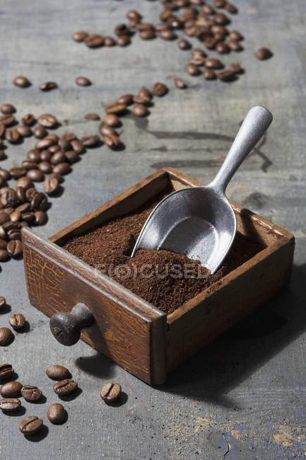Ground coffee beans in drawer — Stock Photo