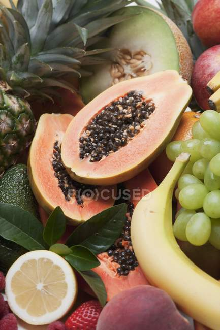 Various halved fruits — Stock Photo