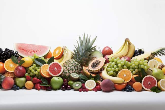 Various fruits in heap — Stock Photo