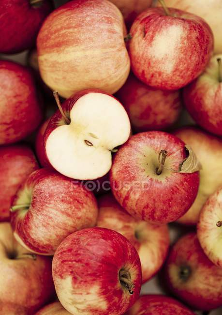 Red ripe apples with half — Stock Photo