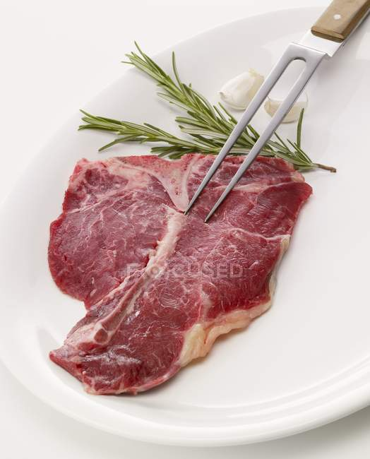 Raw T-bone steak — Stock Photo