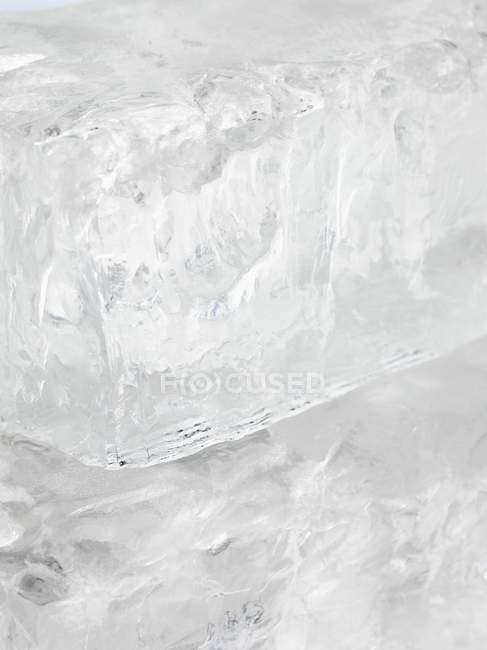 Closeup view of ice block on reflective surface — Stock Photo