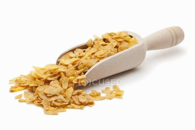 Cornflakes on wooden scoop — Stock Photo
