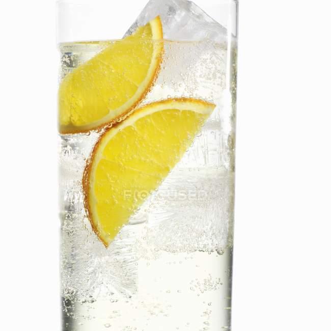 Ice water with orange slices — Stock Photo