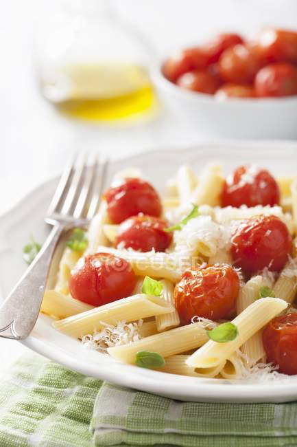 Penne pasta with roasted cherry tomatoes — Stock Photo