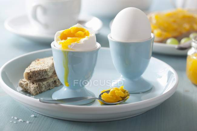 Soft-boiled eggs in egg-cups — Stock Photo