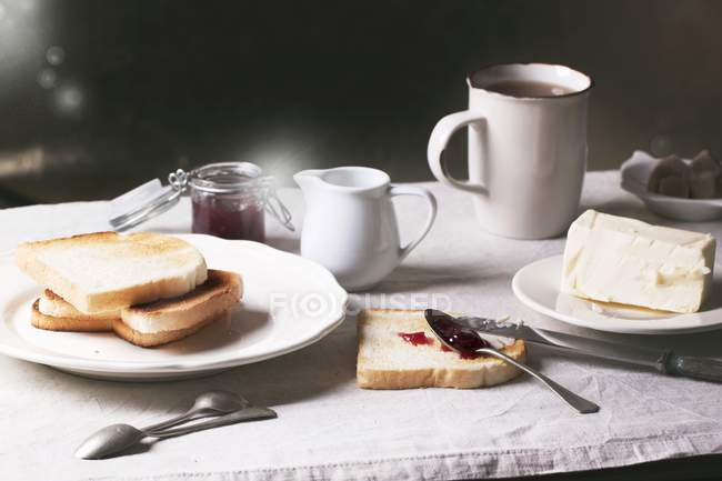 Elevated view of breakfast with toasts, jam and butter — Stock Photo