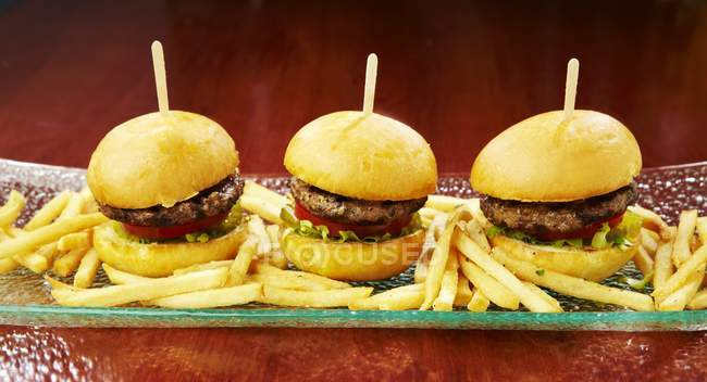 Mini burgers with fries — Stock Photo