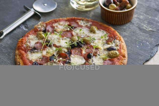Chorizo and olive pizza — Stock Photo