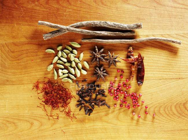 Top view of various spices on wooden surface — Stock Photo