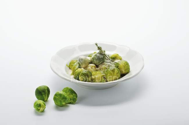 Brussels sprouts in sauce — Stock Photo