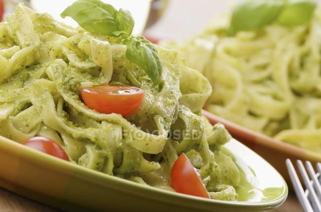 Tagliatelle pasta with pesto — Stock Photo