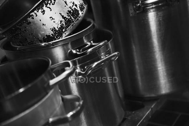 Closeup view of piled metal pots — Stock Photo