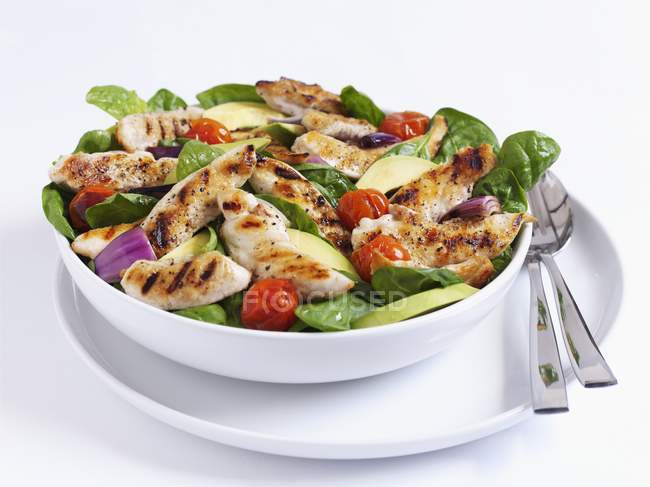 Grilled chicken salad with spinach — Stock Photo